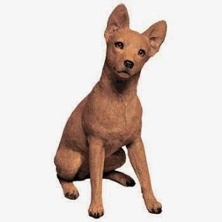 red miniature pinscher figurine statue